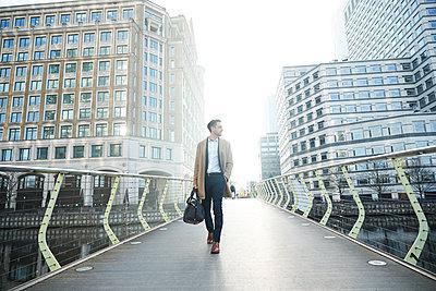 UK, London, Man walking on footbridge - p924m2271238 by Peter Muller