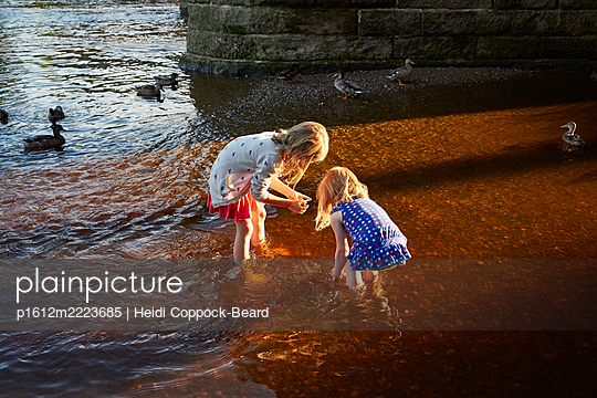 Two young girls playing in the river  - p1612m2223685 by Heidi Coppock-Beard