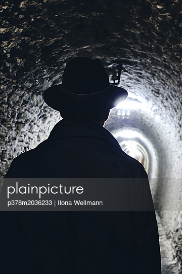Man in tunnel - p378m2036233 by Ilona Wellmann
