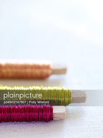 Three spools of metallic thread - p349m2167807 by Polly Wreford