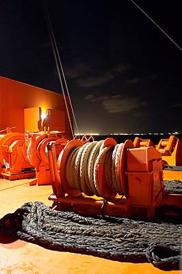 Winch on a conatainer ship - p1099m857164 by Sabine Vielmo