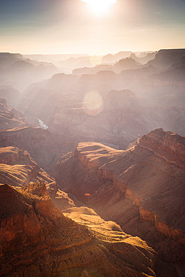A view of a canyon backlit with the sun. - p1424m1501500 by Whit Richardson photography