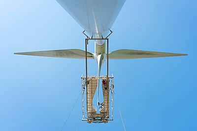 Maintenance work on blades of wind turbine, Biddinghuizen, Flevoland, Netherlands - p429m2019465 by Mischa Keijser