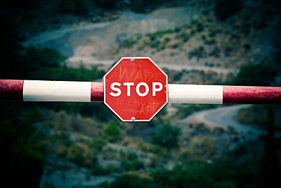 Barrier with stop sign - p4429418f by Design Pics