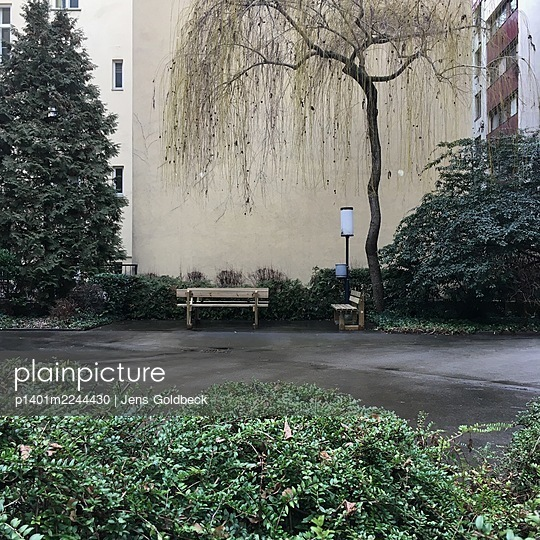 Austria, Vienna, Benches in a residential area - p1401m2244430 by Jens Goldbeck