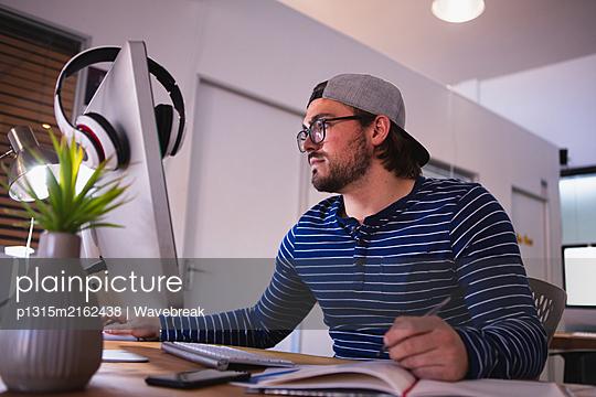 Creatives working in an office - p1315m2162438 by Wavebreak