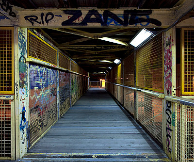 Old iron bridge covered in graffiti in Spain - p1072m829080 by Joan Seculi