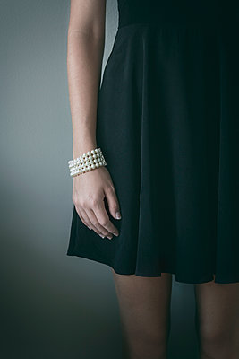 Woman in Black Dress with Pearl Bracelet - p1331m1182434 by Margie Hurwich