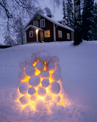 Snow lantern lit up at Christmas - p3489851 by Jan-Peter Lahall