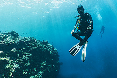 Underwater view of diver hovering at 5 m safety stop over coral reef at the Tubbataha Reefs Natural Park, Cagayancillo, Palawan, Philippines - p429m1578360 by Henn Photography