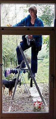 Cleaning the window - p896m834821 by Richard Brocken