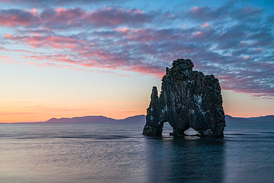 The rock formation known as Hvitserkur, at sunset, Northern Iceland; Iceland - p442m2004305 by Robert Postma