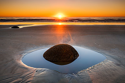 Moeraki Boulders at Sunrise, Otago Coast, New Zealand - p651m2006620 by Tom Mackie