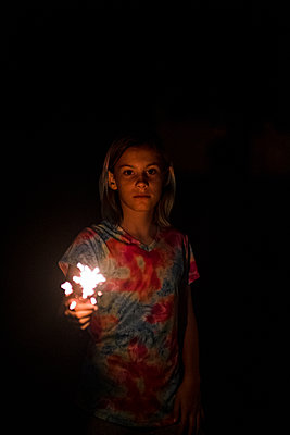 Girl holding sparkler on the 4th of july in kansas city missouri - p1166m2208035 by Cavan Images