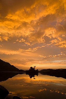 Silhouetted Mountain Lake - p1562m2168154 by chinch gryniewicz