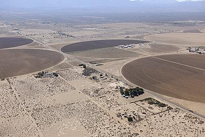 Mojave Desert crop circle farm - p1048m1069305 by Mark Wagner