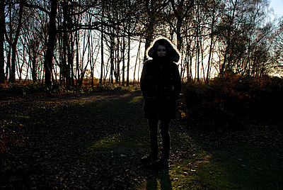 Girl Silhouetted Against Trees - p1304m1136836 by MY MY