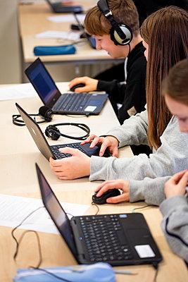 Children in classroom using laptops - p312m2174470 by Scandinav