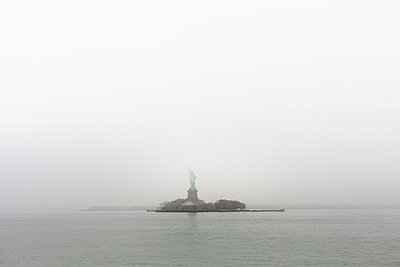 Statue of Liberty on foggy day - p956m892192 by Anna Quinn