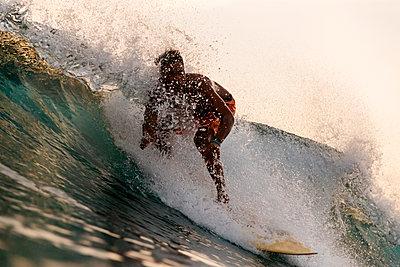 Surfer riding wave, Gerupuk,Lombok, Indonesia - p1166m2202320 by Konstantin Trubavin