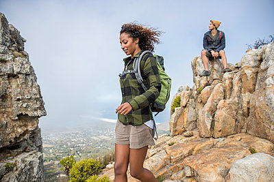 Young couple on mountain peak - p1355m1574150 by Tomasrodriguez