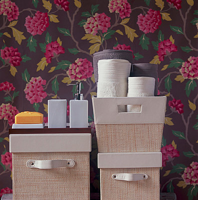 Bathroom storage ideas for towels and toiletries - p349m695230 by Emma Lee
