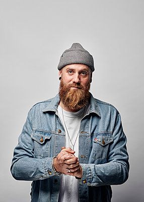 Man in jeans jacket and knit cap - p1124m2229066 by Willing-Holtz