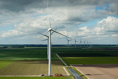 Modern wind farm in the newly created land in the Flevopolder - p429m1047267 by Mischa Keijser
