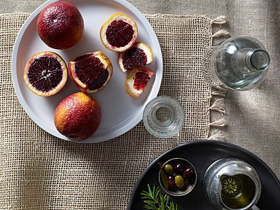 Blood oranges on plate - p9241468 by Ryan Benyi Photography