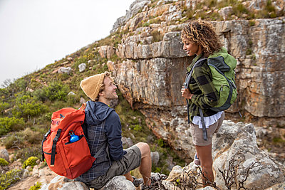 Young couple mountain hiking - p1355m1574155 by Tomasrodriguez