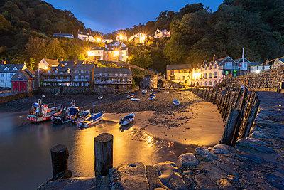 Night time view of Clovelly village in North Devon, England, United Kingdom, Europe - p871m2209433 by Adam Burton
