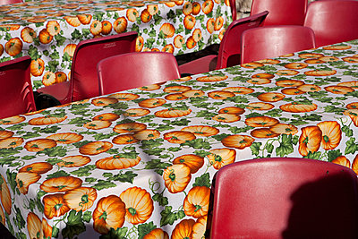 Empty tables and chairs after a pumpkin festival in Italy - p3313592 by Andrea Alborno