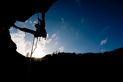 Woman rappelling from cliff in Swanage / UK - p1166m2201843 by Cavan Images