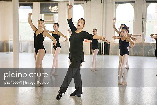 Teacher and ballet dancers