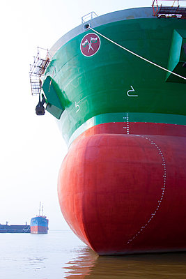 The bow of a new Graiglas ocean tanker docked at the Vinashin shipyard. Vietnam, Southeast Asia - p934m892912 by Matthew Dakin