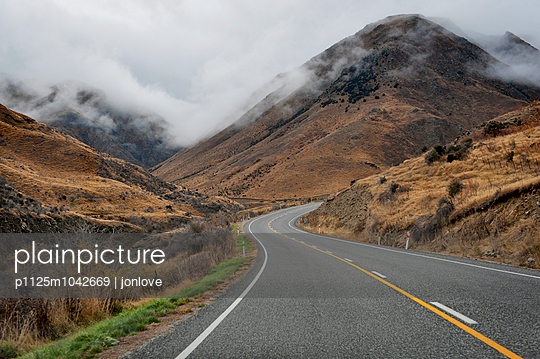 Winding road and fog - p1125m1042669 by jonlove