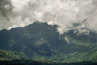 Polynesia, Mystical cloud-covered mountains in Tahiti - p1487m2253943 by Ludovic Mornand