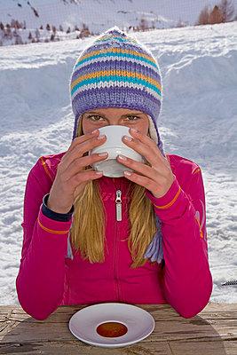 Girl drinking - p4293315f by Britt Erlanson