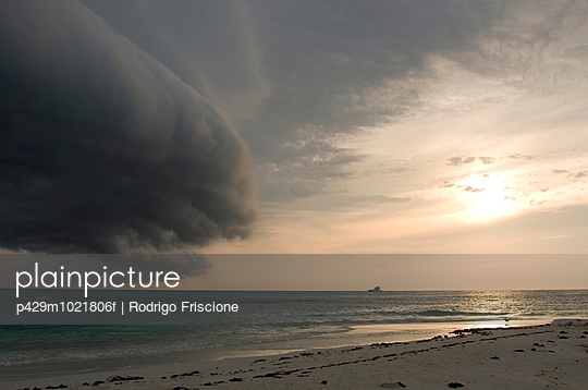 Storm clouds forming on coast of Perez Island at sunset, Gulf of Mexico - p429m1021806f by Rodrigo Friscione