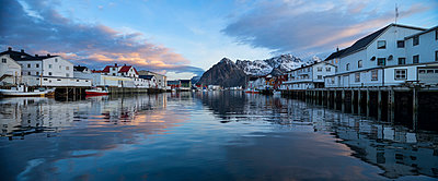 Mountain reflection in Harbour at scenic fishing village of Henningsvær, Austvågøy, Lofoten Islands, Norway - p343m988702f by Cody Duncan