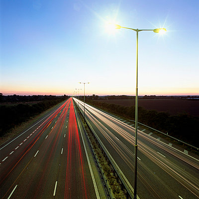 Head and tail-lights on motorway - p92410883f by Image Source