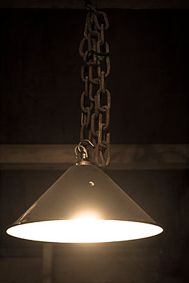 Old lamp in an abandoned building - p1228m1123757 by Benjamin Harte