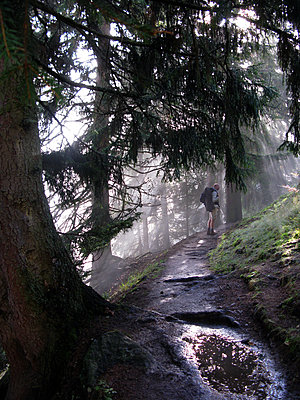 Man hiking in mystical light - p1354m2292918 by Kaiser