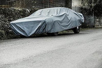 Vintage car covered with tarpaulin  - p1057m1502828 by Stephen Shepherd