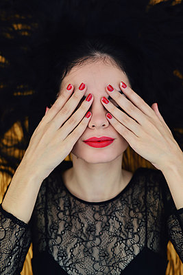 Young woman covers eyes with her hands - p1695m2290954 by Dusica Paripovic