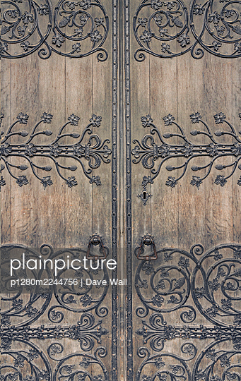Ornaments on medieval wooden door - p1280m2244756 by Dave Wall