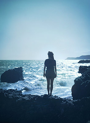 Girl on the rocks - p984m1064843 by Mark Owen