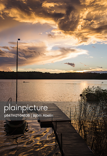 Scenic View Of Moored Boat At Lake During Sunset, Sweden   - p847m2104838 by Björn Abelin