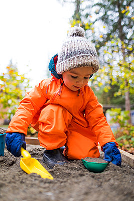 Portrait of toddler playing in sandbox, Abbotsford, British Columbia, Canada - p1166m2202109 by Christopher Kimmel / Alpine Edge Photography