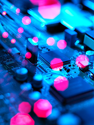 Fibre optics carrying data passing across electronic circuit board - p300m2131647 by Andrew Brookes
